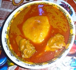 fufu, chicken, and groundnut soup in ghana in africa