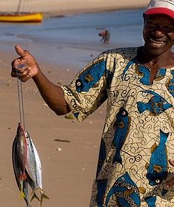 African man holding fish